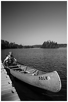 Canoist at dock, Tobin Harbor. Isle Royale National Park ( black and white)