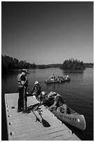 Canoists disembarking, Tobin Harbor. Isle Royale National Park ( black and white)
