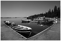 Small boats moored at marina, Rock Harbor. Isle Royale National Park ( black and white)