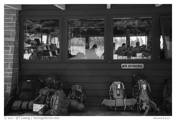 Backpacks lined behind visitor center, Rock Harbor. Isle Royale National Park (black and white)