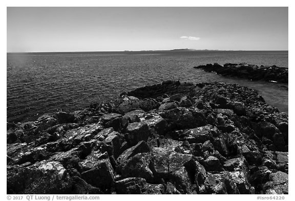 Lichen-covered rocks, Lake Superior, and Isle Royale from Passage Island. Isle Royale National Park (black and white)