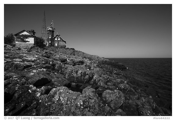 Lichen-covered rocks and Lighthouse, Passage Island. Isle Royale National Park (black and white)