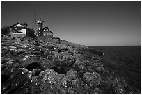 Lichen-covered rocks and Lighthouse, Passage Island. Isle Royale National Park ( black and white)