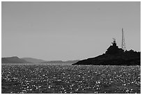 Lighthouse on Passage Island with Isle Royale in the distance. Isle Royale National Park ( black and white)