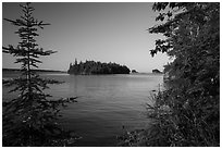 Islands of archipelago framed by trees from Tookers Island. Isle Royale National Park ( black and white)