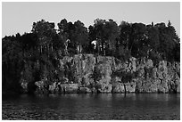 Sea cliffs and trees, late afternoon. Isle Royale National Park ( black and white)