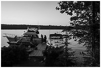 Dock with several boats moored, Tookers Island. Isle Royale National Park ( black and white)