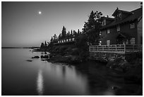 Rock Harbor Lodge and moon at dusk. Isle Royale National Park ( black and white)