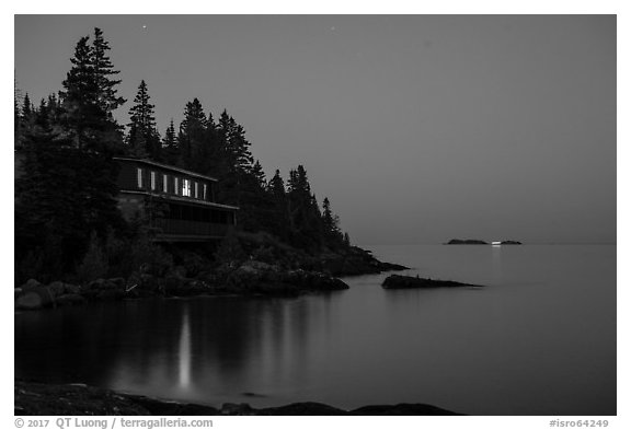 Rock Harbor Lodge at night with di Rock Harbor Lodge and moon at duskstant ship in shipping lane in front of Passage Island. Isle Royale National Park (black and white)
