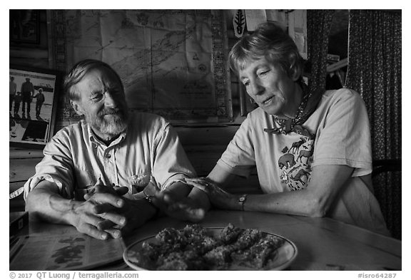 Rolf Peterson and Carolyn Peterson with plate of rhubarb pie in their home. Isle Royale National Park (black and white)