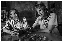 Rolf Peterson and Carolyn Peterson with plate of rhubarb pie in their home. Isle Royale National Park ( black and white)