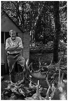 Rolf Peterson and moose skull and antlers collection. Isle Royale National Park ( black and white)