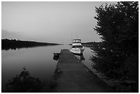 Moskey Basin dock with motorboat and ycaht, dusk. Isle Royale National Park ( black and white)
