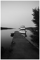 Motorboat and yacht moored at Moskey Basin dock. Isle Royale National Park ( black and white)