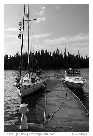 Sailboat and motorboat moored at Rock Harbor. Isle Royale National Park (black and white)