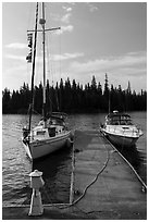 Sailboat and motorboat moored at Rock Harbor. Isle Royale National Park ( black and white)