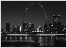 Arch and downtown skyline at night from East St Louis. Gateway Arch National Park ( black and white)