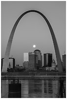 Moonset framed by Arch across Mississippi River. Gateway Arch National Park ( black and white)