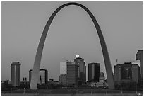 Moonset, downtown buildings, Old Courthouse, framed by Arch. Gateway Arch National Park ( black and white)