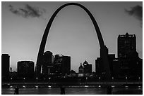 Arch and Old Courthouse across Mississippi River at sunset. Gateway Arch National Park ( black and white)