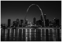 Arch, Old Courthouse and skyline reflected in Mississippi River at night. Gateway Arch National Park ( black and white)