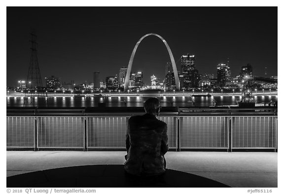 St Louis skyline and Malcom Martin statue from Mississippi River Overlook at night. Gateway Arch National Park (black and white)