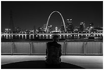 St Louis skyline and Malcom Martin statue from Mississippi River Overlook at night. Gateway Arch National Park ( black and white)