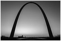 Arch at sunrise with curve of new visitor center roof. Gateway Arch National Park ( black and white)