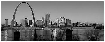 St Louis skyline across Mississippi River at sunrise. Gateway Arch National Park (Panoramic black and white)