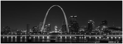 St Louis skyline from Mississippi River Overlook at night. Gateway Arch National Park (Panoramic black and white)