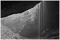 Rain-fed waterfall seen from inside cave. Mammoth Cave National Park, Kentucky, USA. (black and white)