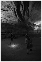 Ranger talking to family in cave. Mammoth Cave National Park ( black and white)