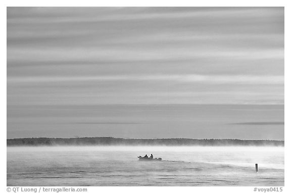 Boaters in fog, early morning, Kabetogama lake. Voyageurs National Park (black and white)