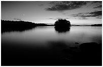 Sunset with moon on island on Kabetogama Lake near Ash river. Voyageurs National Park, Minnesota, USA. (black and white)