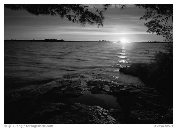 Sun rising on Kabetogama lake. Voyageurs National Park (black and white)