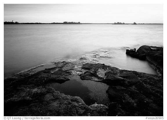 Lake and eroded granite at sunrise. Voyageurs National Park (black and white)