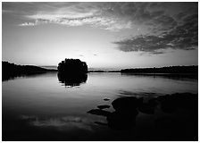 Kabetogama lake sunset with tree-covered islet. Voyageurs National Park ( black and white)