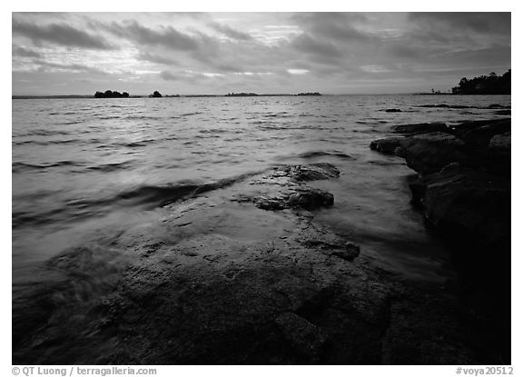 Lakeshore with eroded granite slab and clouds. Voyageurs National Park (black and white)