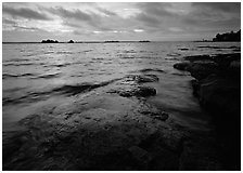 Lakeshore with eroded granite slab and clouds. Voyageurs National Park, Minnesota, USA. (black and white)