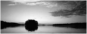 North woods tree-covered isled at sunset. Voyageurs National Park (Panoramic black and white)