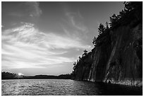 Sun setting and Grassy Bay Cliffs at sunset. Voyageurs National Park ( black and white)