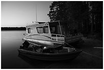 Motorboat and houseboat at dusk, Houseboat Island. Voyageurs National Park ( black and white)