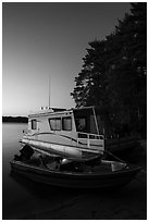 Motorboat and houseboat at dusk, Houseboat Island, Sand Point Lake. Voyageurs National Park ( black and white)