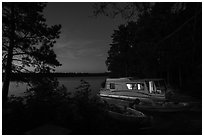 Houseboat lit from within at night, Sand Point Lake. Voyageurs National Park ( black and white)