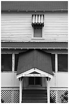 Kettle Falls Hotel door and window with red and white stripes awning. Voyageurs National Park ( black and white)