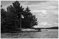 Islet with Canadian flag, Namakan Lake. Voyageurs National Park ( black and white)