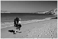 Backpacker on beach, Cuyler harbor, San Miguel Island. Channel Islands National Park, California, USA. (black and white)