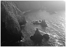 Cliffs and pointed rocks, Cathedral Cove, late afternoon, Anacapa Island. Channel Islands National Park, California, USA. (black and white)