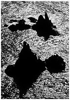 Backlit rocks and water, Cathedral Cove, Anacapa, late afternoon. Channel Islands National Park, California, USA. (black and white)