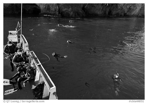 Diving boat and scuba divers in water, Annacapa. Channel Islands National Park (black and white)